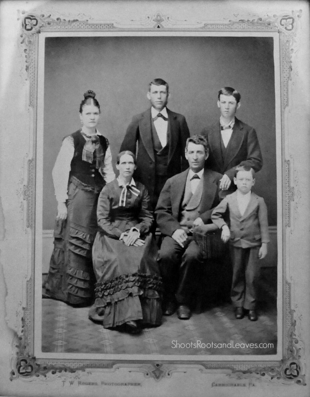 Family Portrait taken by T W Rogers, Carmichaels, Pennsylvania, circa 1874.  Standing: Sarah, John P., Olfred Minor.  Seated: Mary Jane Gwynn and Francis Marion Minor.  Standing front: Robert Minor (b. 1869) Photo recovered from Minor Home Farm circa 1965